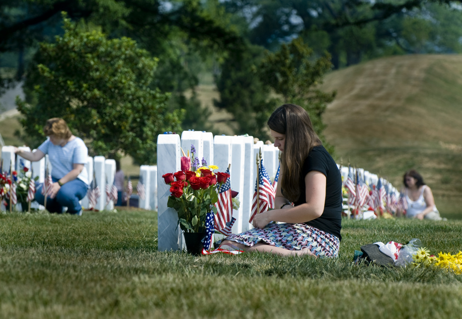 Amanda Lamb, 21, sits in front of a headstone in Section 60 of Arlington National Cemetery on Memorial Day weekend. The stone marks the grave of her best friend, U.S. Army Spc. Justin Allan Rollins, a member of the 82nd Airborne.Rollins, 22, died on March 5, 2007, when an improvised explosive device detonated near his convoy in Samarra, Iraq.