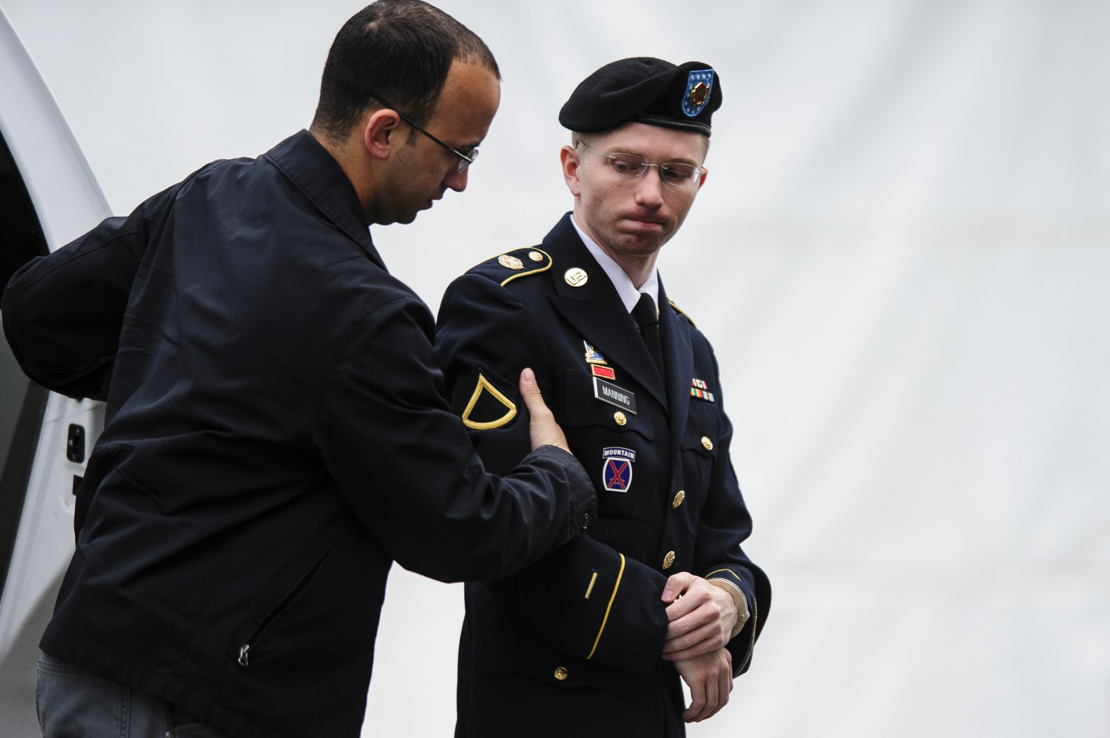 US Army Private Bradley Manning, charged with leaking classified documents to the WikiLeaks website, arrives at the courtroom for the fourth day of his court-martial at Fort Meade, Maryland, USA, 10 June 2013.