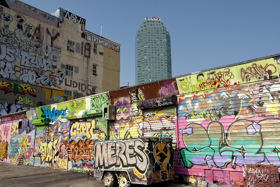 Graffiti artists practice their craft on an old warehouse in Long Island City, New York.
