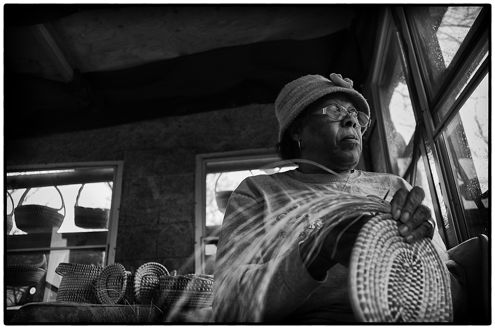 Alma Washington, 76, sews sweetgrass baskets in her stand along Highway 17 in Mt. Pleasant. Sweetgrass basketmaking has been part of the Charleston and Mt. Pleasant communities for over 300 years. Basketmaking is a traditional Gullah art form which has been passed on from generation to generation. It is considered one of the oldest art forms of African origin in the United States.