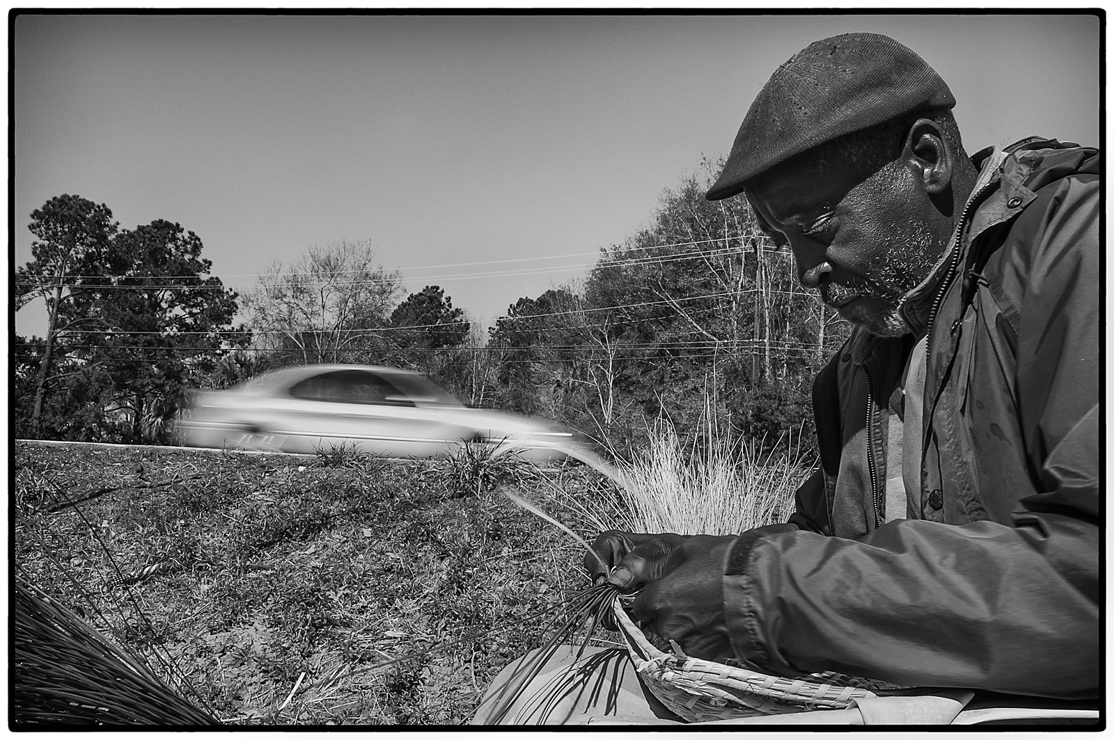 Eugene Gilliard, 60, sews sweetgrass baskets along Highway 17 in Mt. Pleasant. He lives in an area known as 7 mile. Gilliard and his family have been selling baskets on the side of the road since 1947.