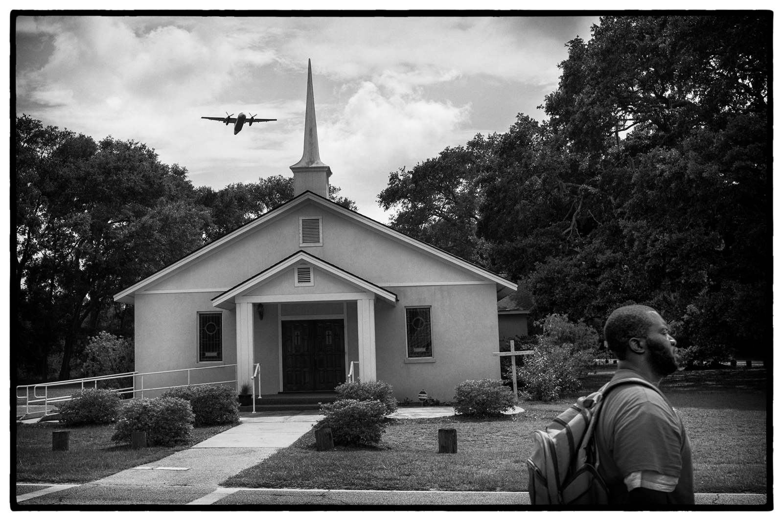 A US Airways plane passes over St. James Baptist Church as it takes off from the Hilton Head airport.