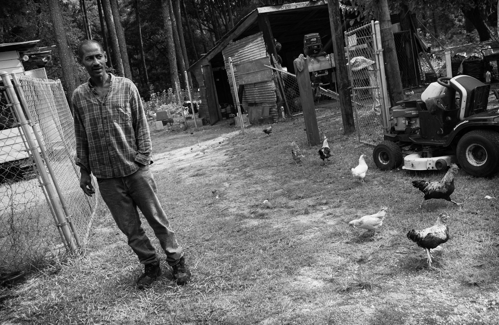 Clarence Simmons stands in his yard on Daufuskie Island.