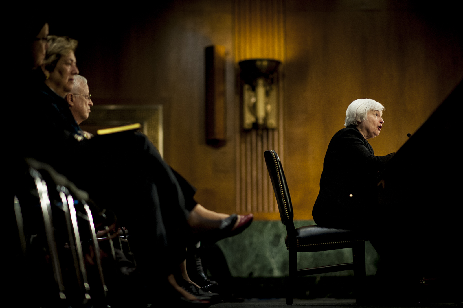 Janet Yellen, vice chairman of the U.S. Federal Reserve and U.S. President Barack Obama's nominee as chairman of the Federal Reserve, testifies before a Senate Banking Committee confirmation hearing in Washington, D.C., U.S., on Thursday, Nov. 14, 2013. Yellen signaled she will carry on the central bank's unprecedented stimulus until she sees improvement in an economy that's operating well below potential. Pete Marovich/Bloomberg