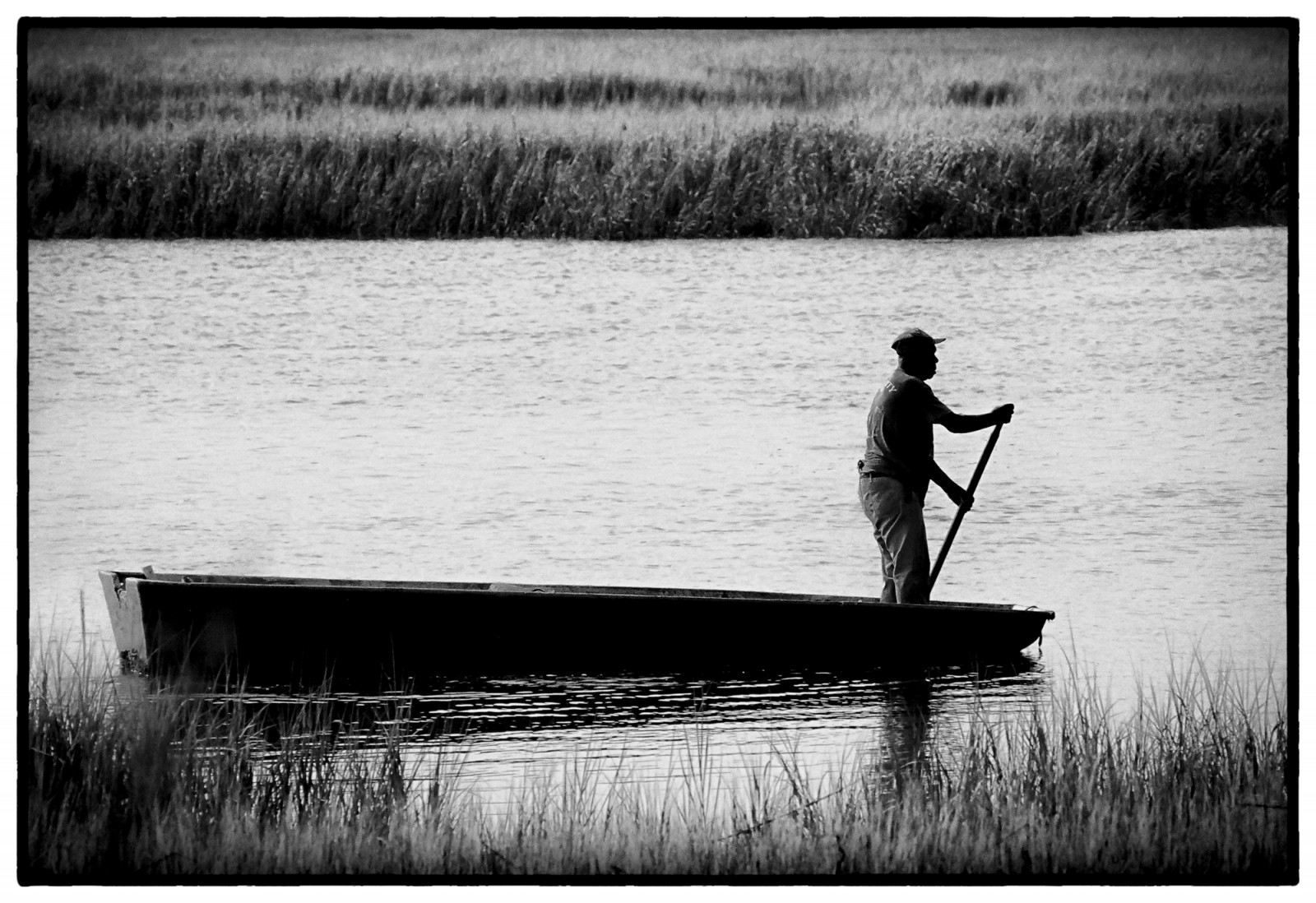 Hilton Head Native Islander Harry Murray pilots his bateau boat in a creek off of Hilton Head Island. Bateau boats, shallow-draft, flat-bottomed boats, were important for transportation, as well as fishing. There are very few Gullah Geechee that still use them and finding someone who still makes them by hand is rare.
