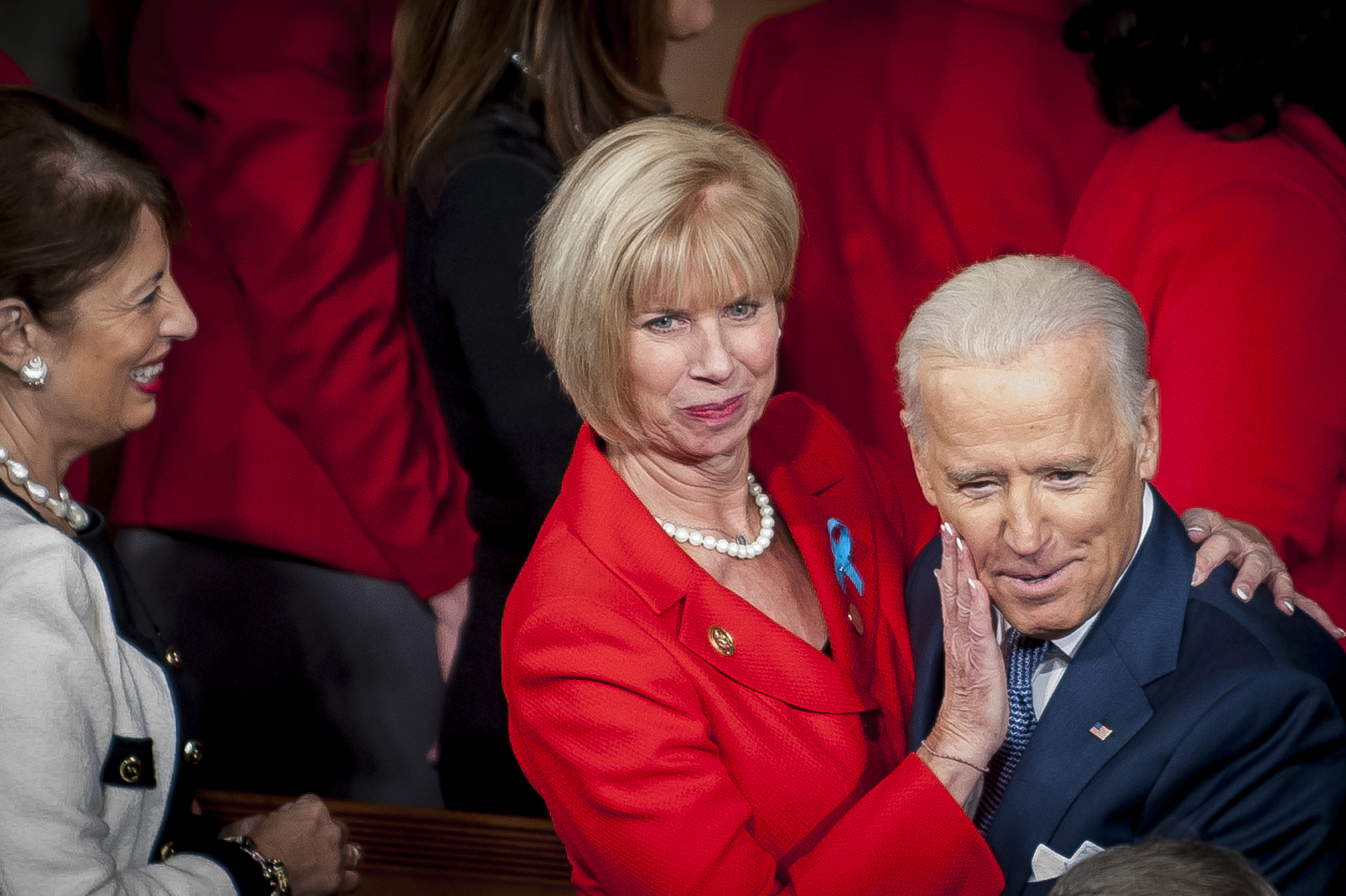 Representative Janice Hahn (D-CA) wipes her lipstick from the cheek of Vice President Joe Biden as he arrives for President Barack Obama's State of the Union address to a joint session of Congress at the Capitol in Washington, D.C., U.S., on Tuesday, Jan. 28, 2014. Photographer: Pete Marovich/Bloomberg