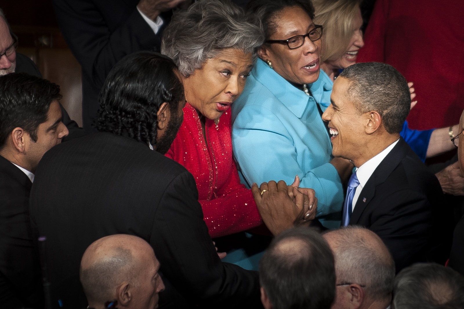 U.S. President Barack Obama is greeted by Rep. Joyce Beatty (D-OH) as he arrives in the House Chamber to deliver the State of the Union address to a joint session of Congress at the Capitol in Washington, D.C., U.S., on Tuesday, Jan. 28, 2014. Photographer: Pete Marovich/Bloomberg