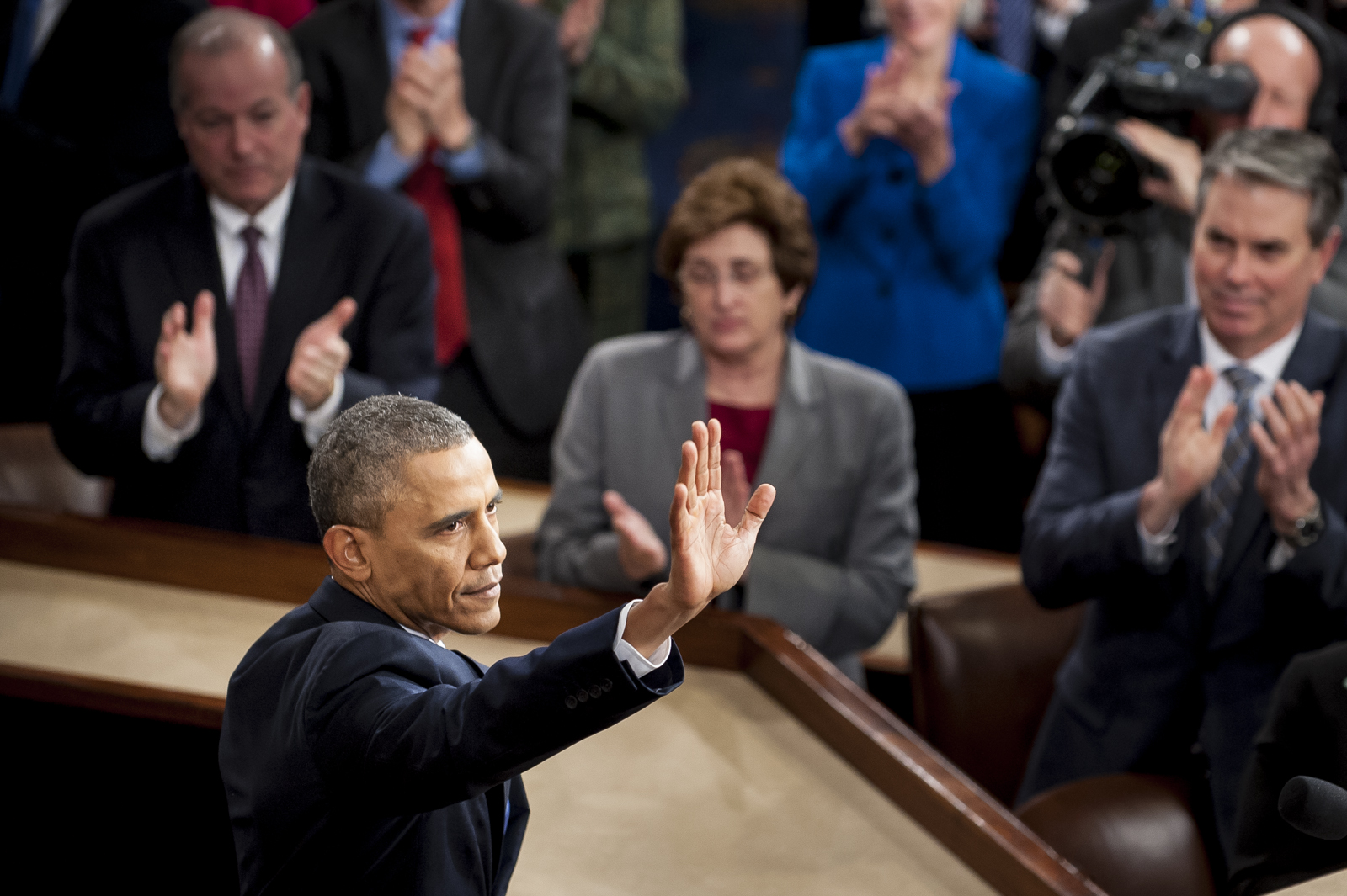 U.S. President Barack Obama waves to the gallery following his State of the Union address to a joint session of Congress at the Capitol in Washington, D.C., U.S., on Tuesday, Jan. 28, 2014. Photographer: Pete Marovich/Bloomberg