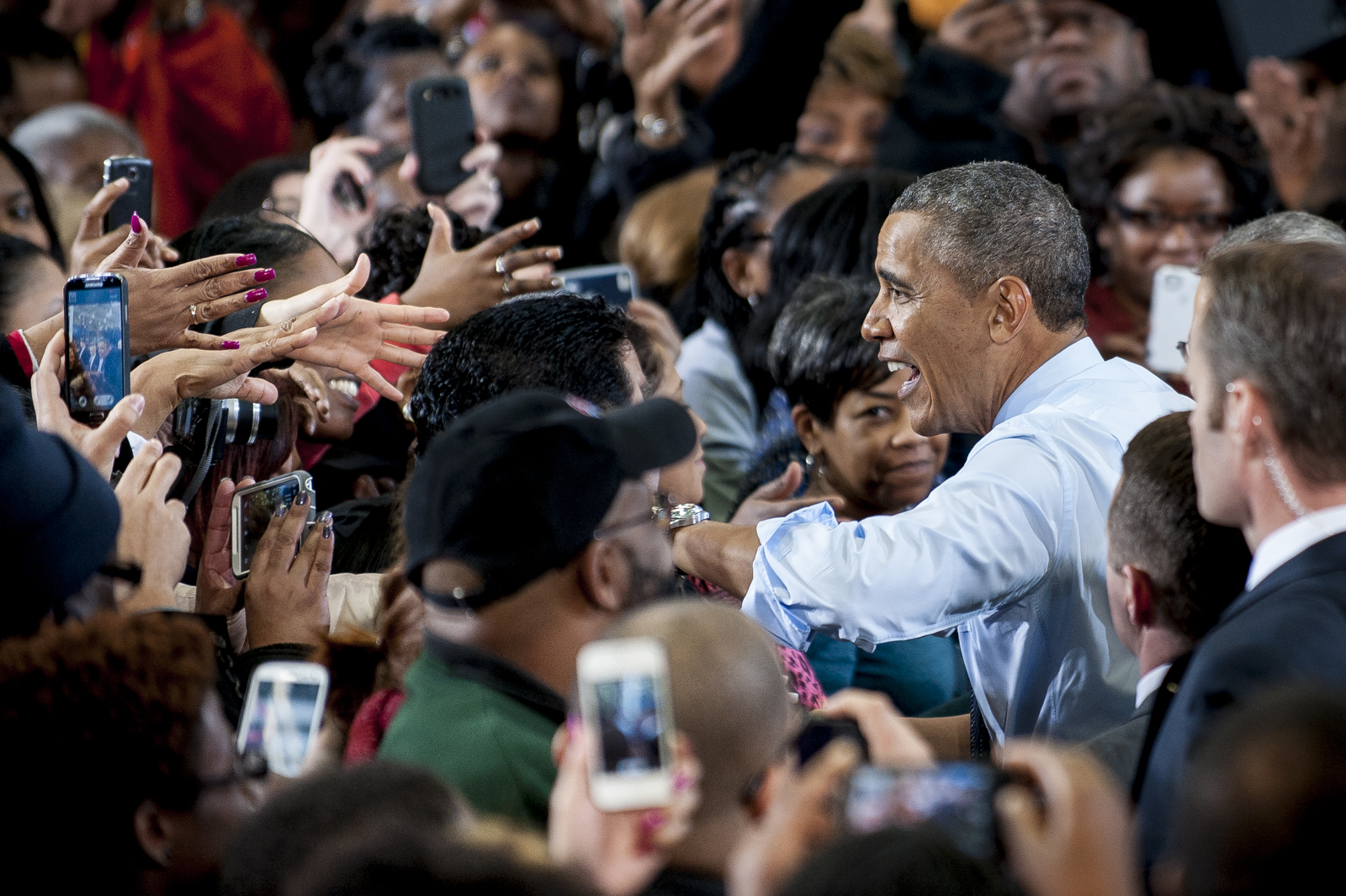 President Barack Obama works the rope line after delivering remarks after touring a Costco in Lanham, Maryland.  Obama highlighted the importance of raising the federal minimum wage for all Americans and reiterate his commitment to working with Congress to pass the Harkin-Miller bill.
