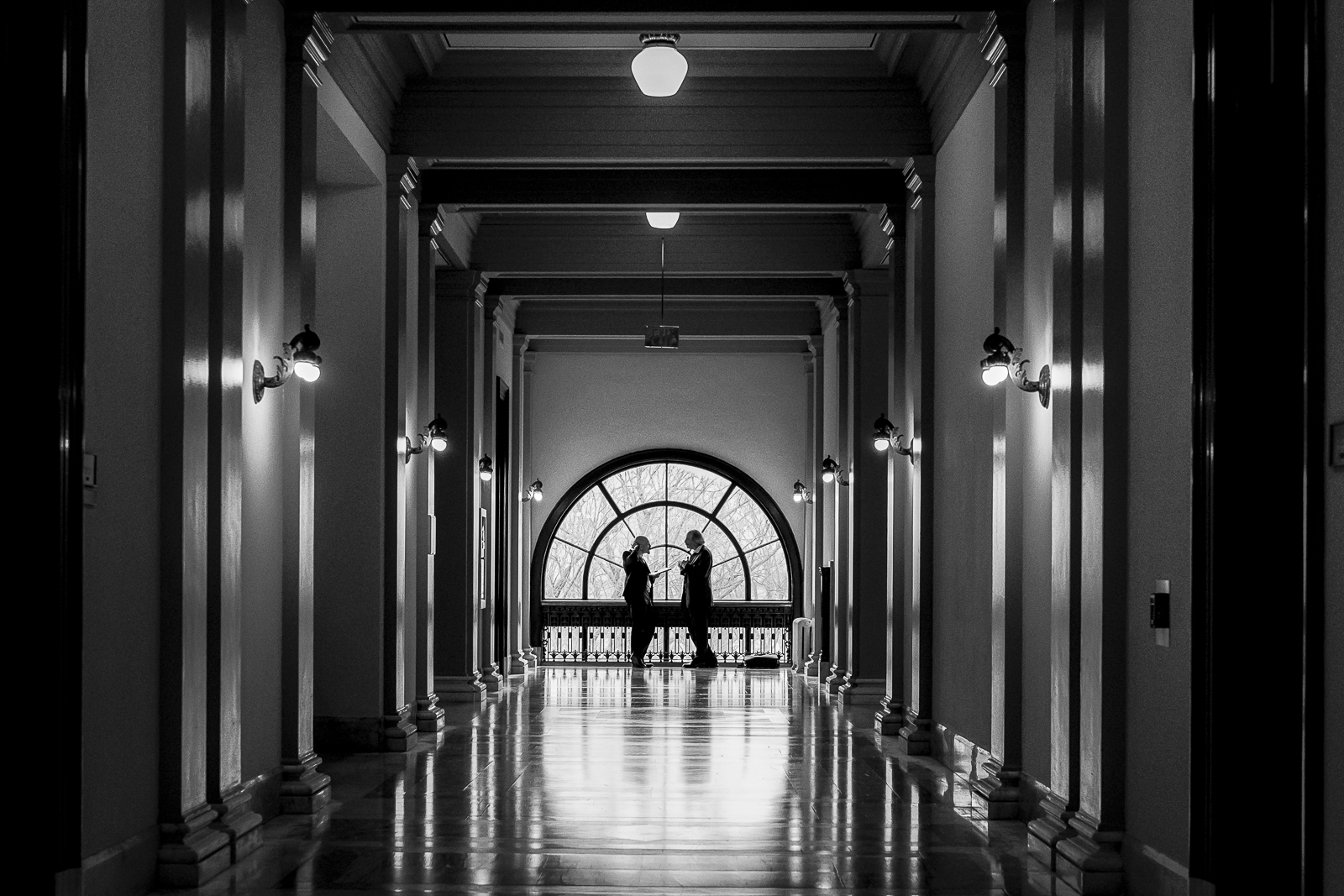 Two men hold a meeting in the hallway of the Russell Senate Office Building on Capitol Hill in Washington, D.C.