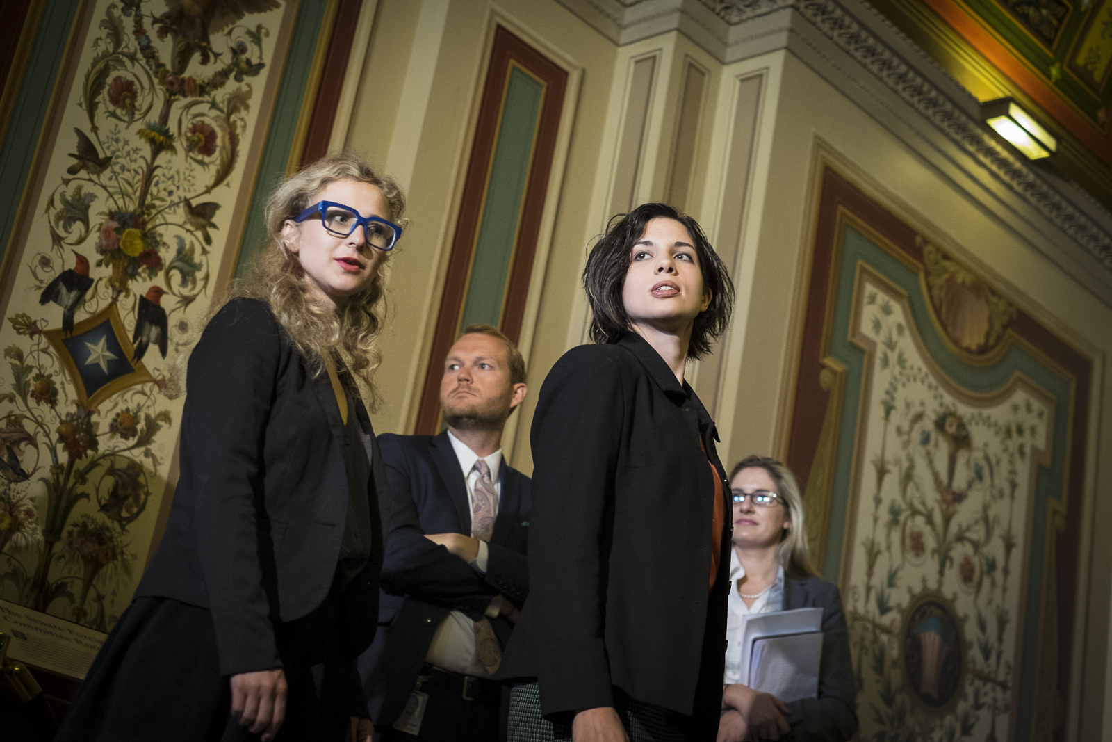 Maria Alyokhina (L) and Nadya Tolokonnikova, members of the Russian feminist punk rock protest group, Pussy Riot, arrive for a press conference with the Senator Foreign Relations Committee on Capitol Hill in Washington, D.C., to discuss the state of human rights in Russia.