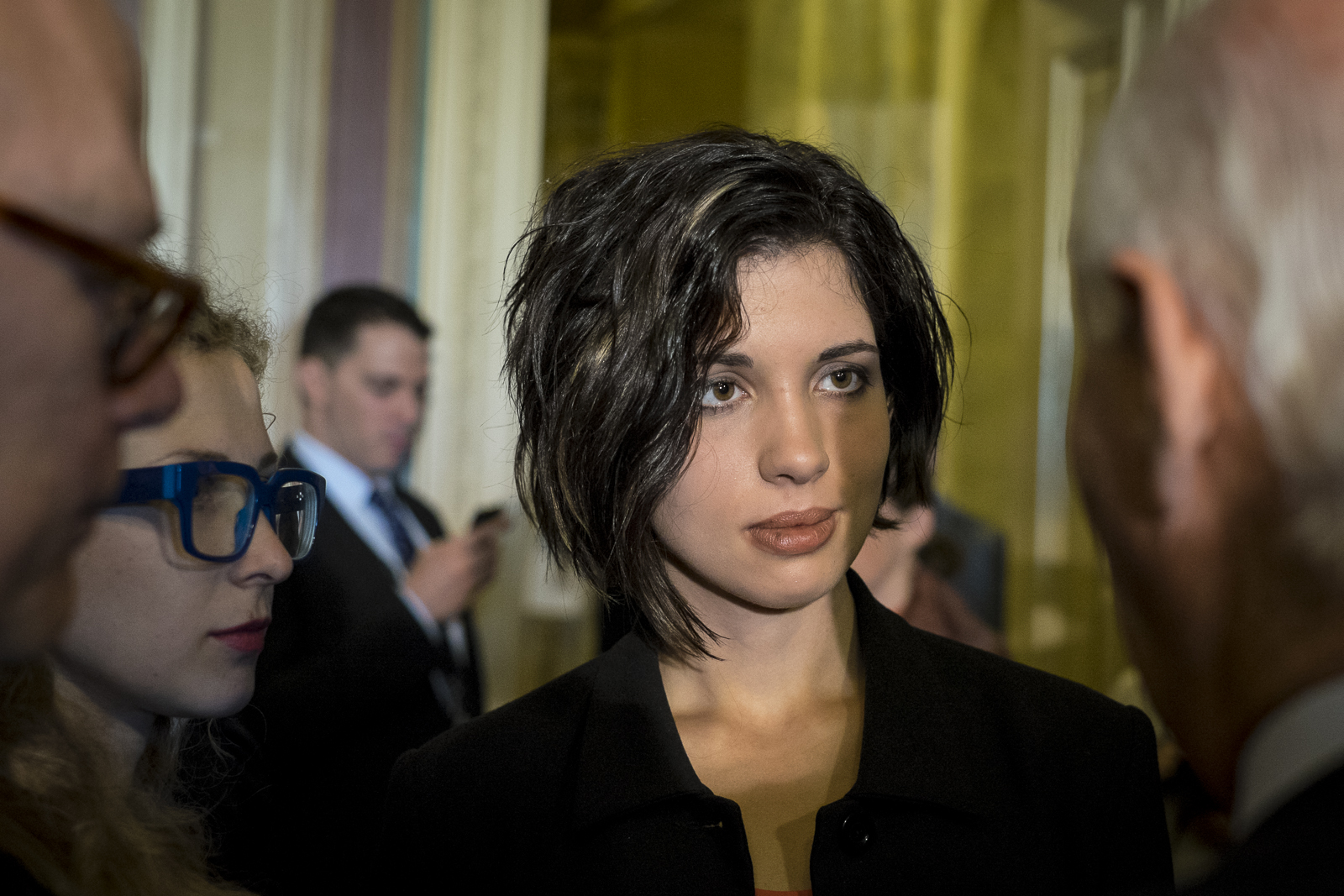 Maria Alyokhina (L) and Nadya Tolokonnikova, members of the Russian feminist punk rock protest group, Pussy Riot, confer with  Senator Ben Cardin (D-MD) following a press conference on Capitol Hill in Washington, D.C., to discuss the state of human rights in Russia.
