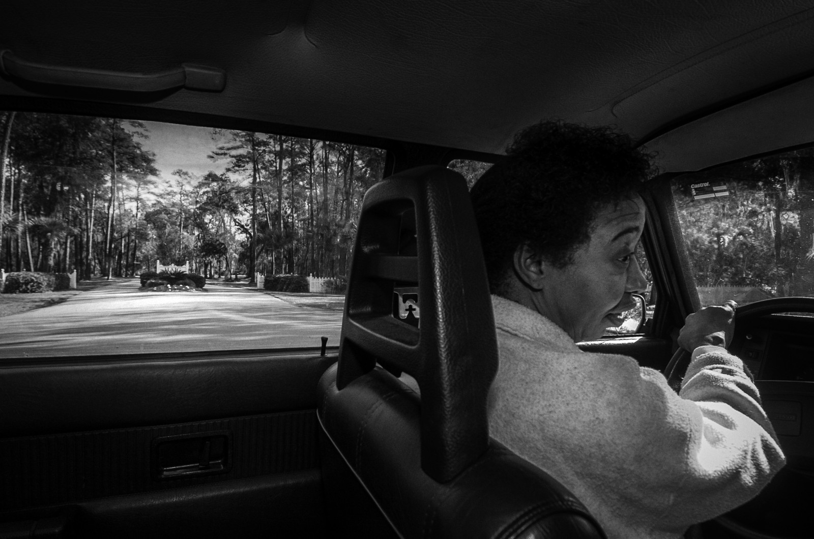 "Yvonne Wilson drives past the ""Pearly Gates"" of Haig Point Plantation. Her infant son is buried in a Gullah family cemetery inside the private residential community where a waterfront lot can cost as much as a half a million dollars."