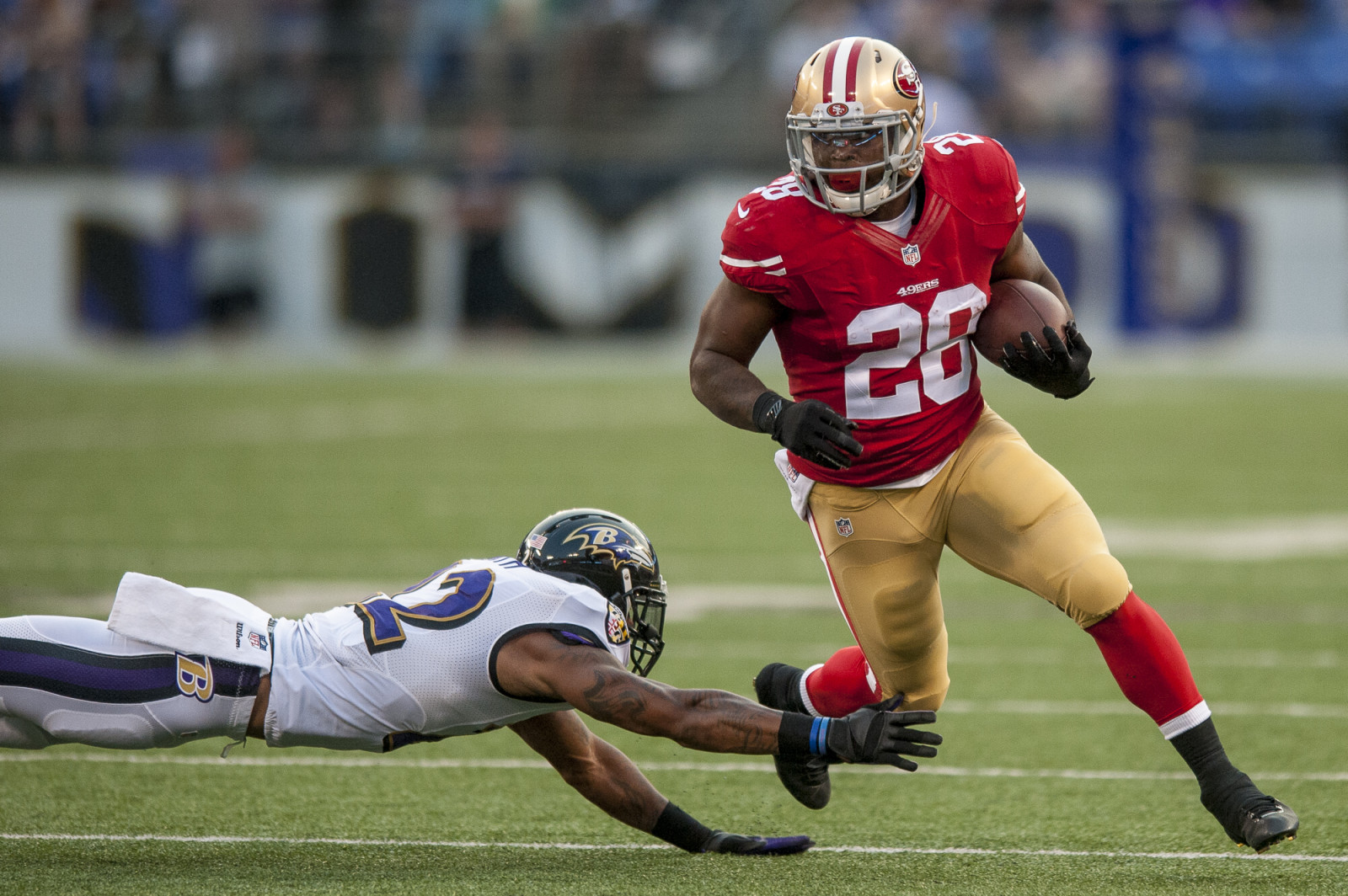 San Francisco 49ers' running back Carlos Hyde turns the corner in the first quarter against the Baltimore Ravens during their pre-season game at M&T Bank Stadium on August 7, 2014 in Baltimore, Maryland. UPI/Pete Marovich