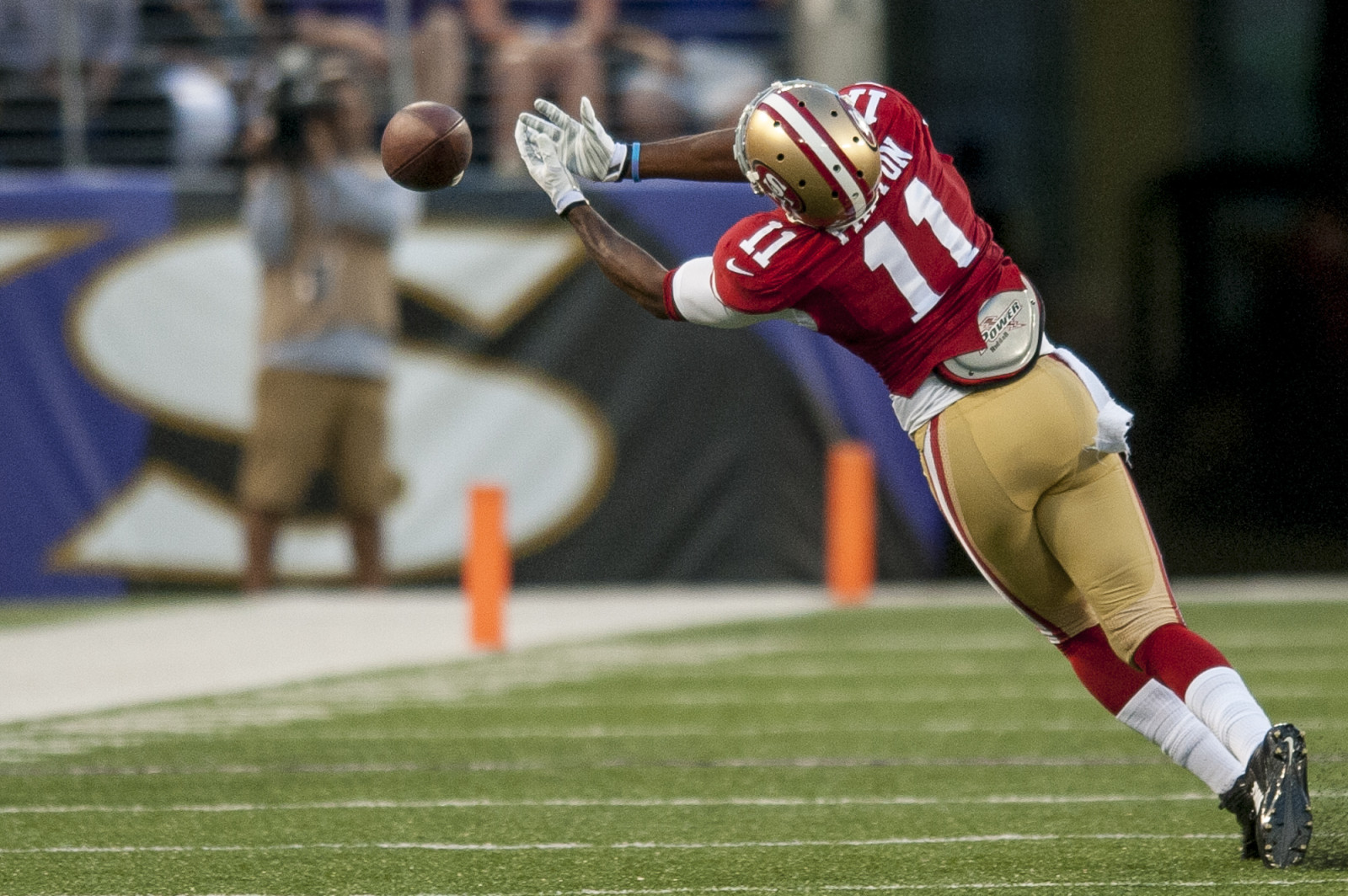 San Francisco 49ers' wide-receiver Quinton Patton has a pass slip though his hands in the first quarter against the Baltimore Ravens during their pre-season game at M&T Bank Stadium on August 7, 2014 in Baltimore, Maryland. UPI/Pete Marovich