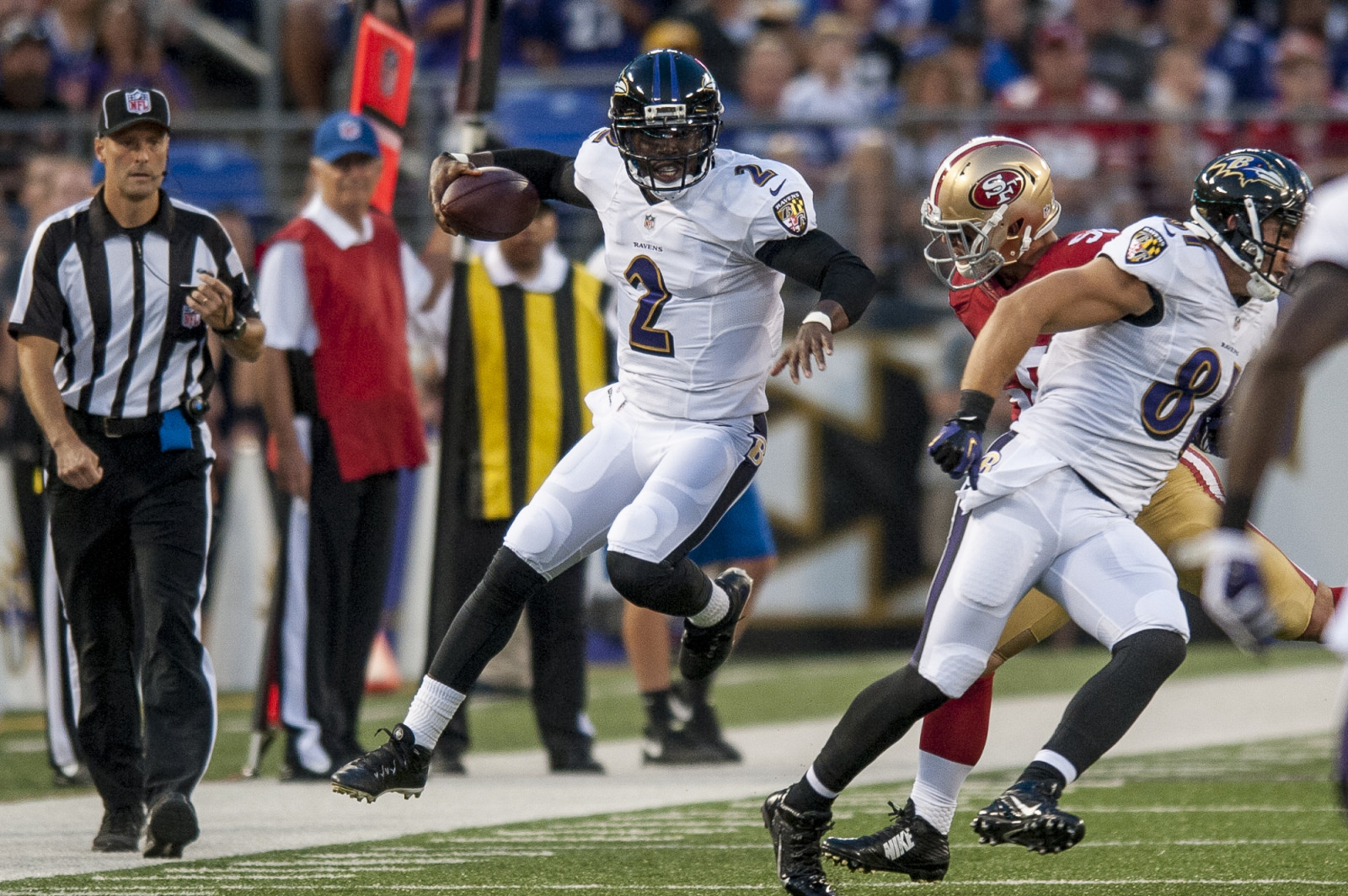 Baltimore Ravens quarterback Tyrod Tayor runs the ball against the San Francisco 49ers during the first quarter of their pre-season game at M&T Bank Stadium on August 7, 2014 in Baltimore, Maryland. UPI/Pete Marovich