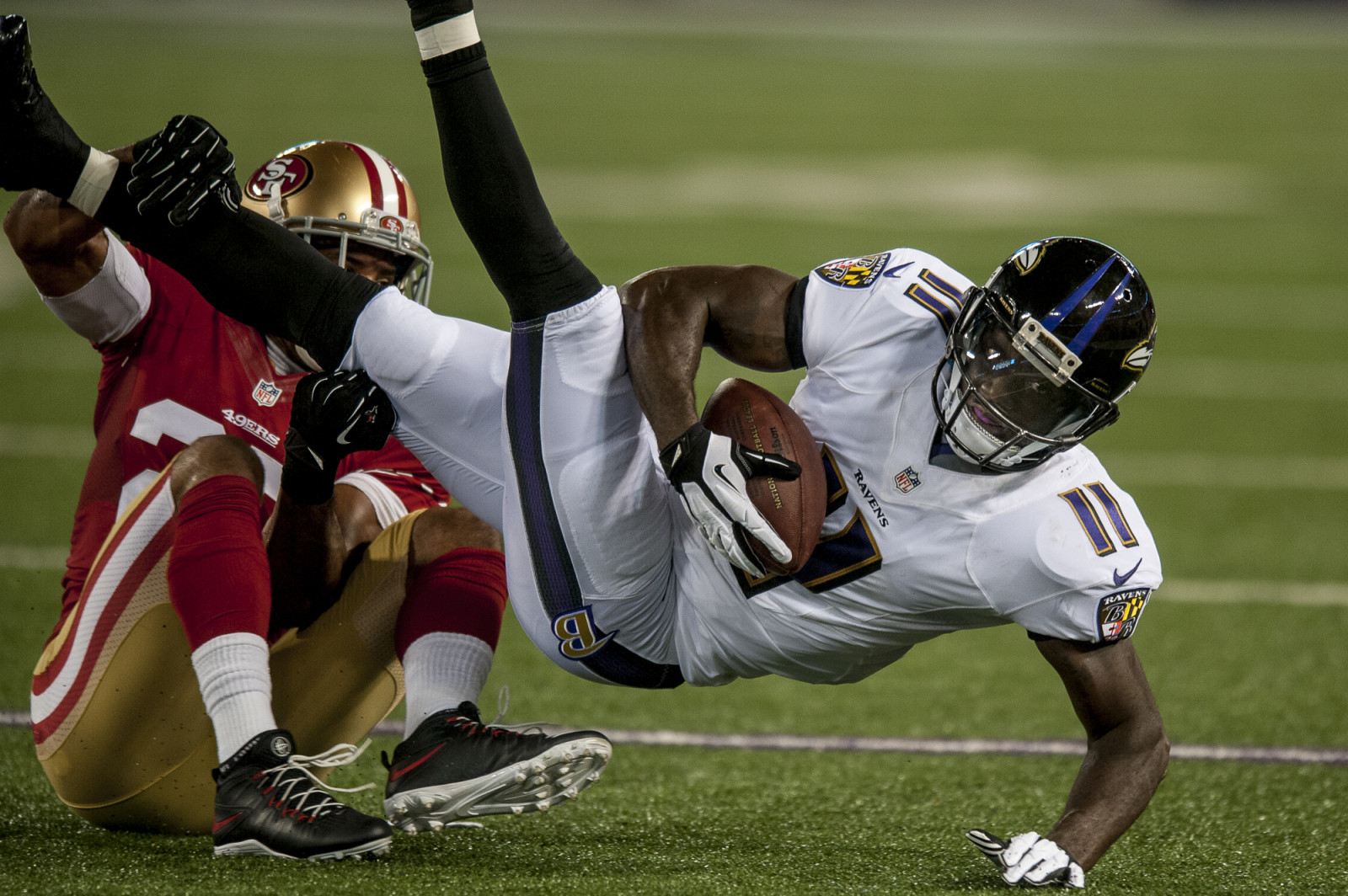 Baltimore Ravens wide-receiver Kamar Aiken is tackled during the second half against the San Francisco 49ers during the first quarter of their pre-season game at M&T Bank Stadium on August 7, 2014 in Baltimore, Maryland. UPI/Pete Marovich