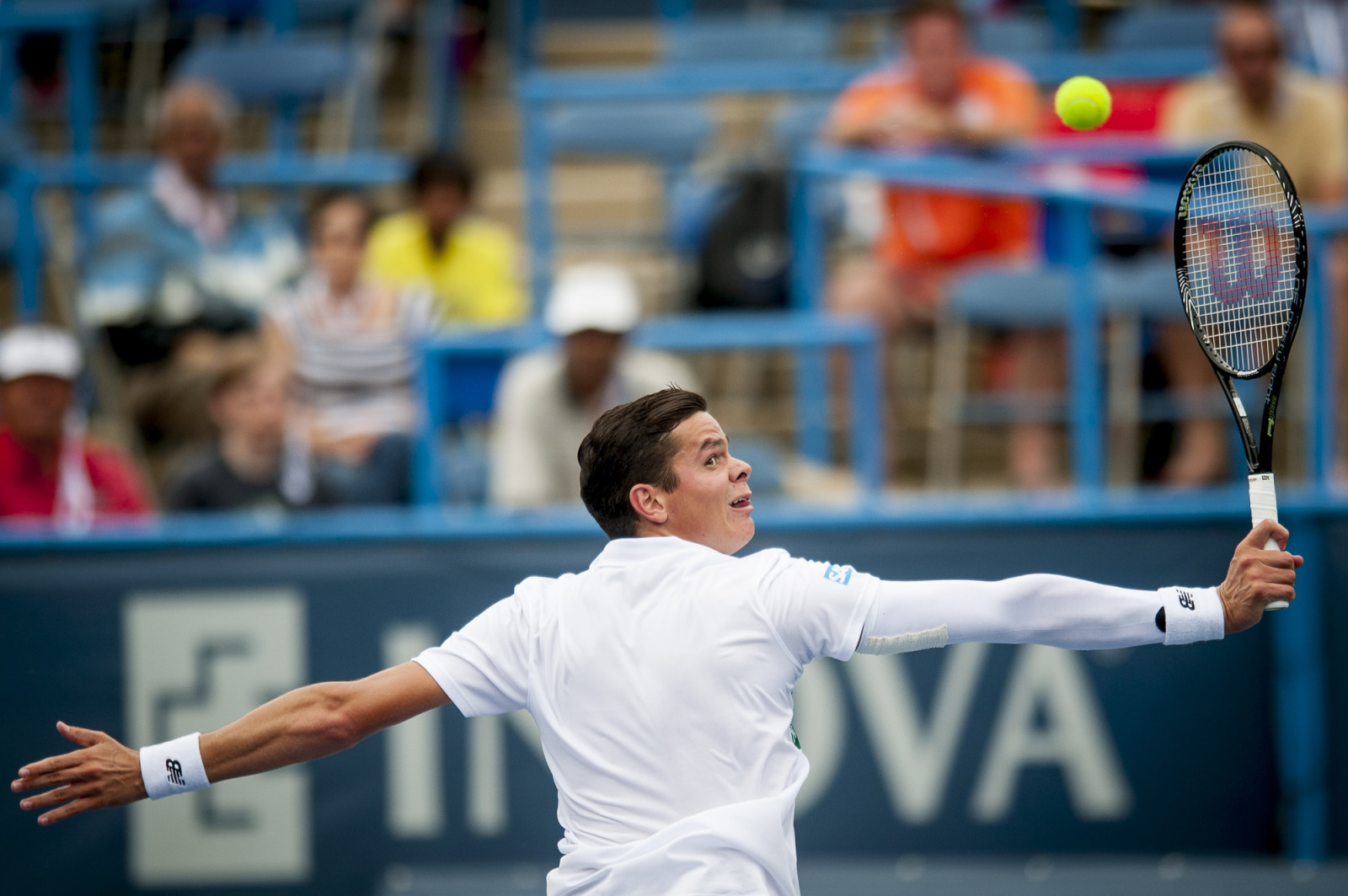 Milos Raonic of Canada returns a shot to Steve Johnson of the United States during their singles match at the Citi Open ATP tennis tournament in Washington, DC, USA, 1 Aug 2014.
