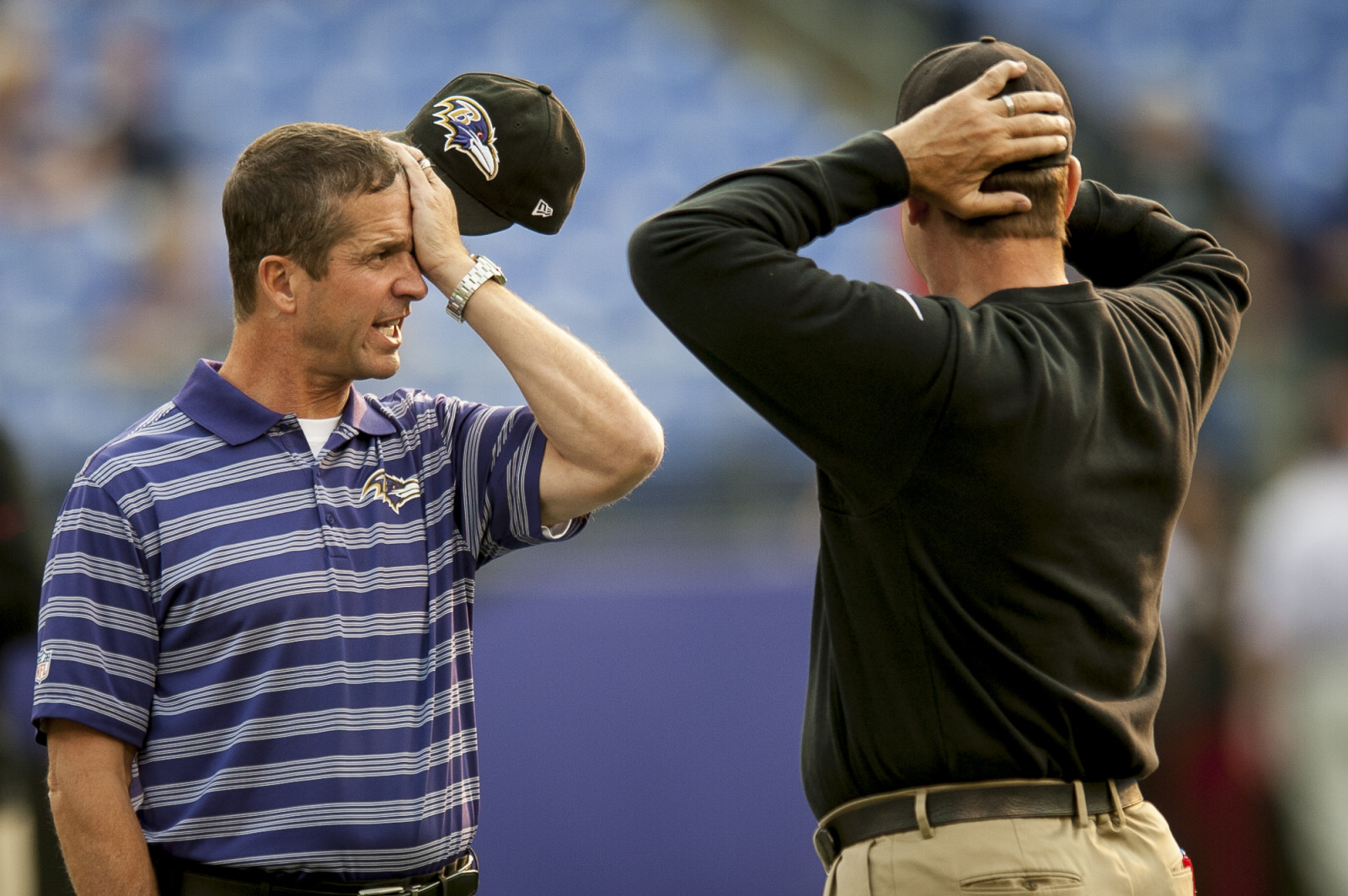 Baltimore Ravens head coach John Harbaugh talks with his brother and 49ers head coach, Jim Harbaugh before their preseason game against the San Francisco 49ers at M&T Bank Stadium on August 7, 2014 in Baltimore, Maryland. UPI/Pete Marovich