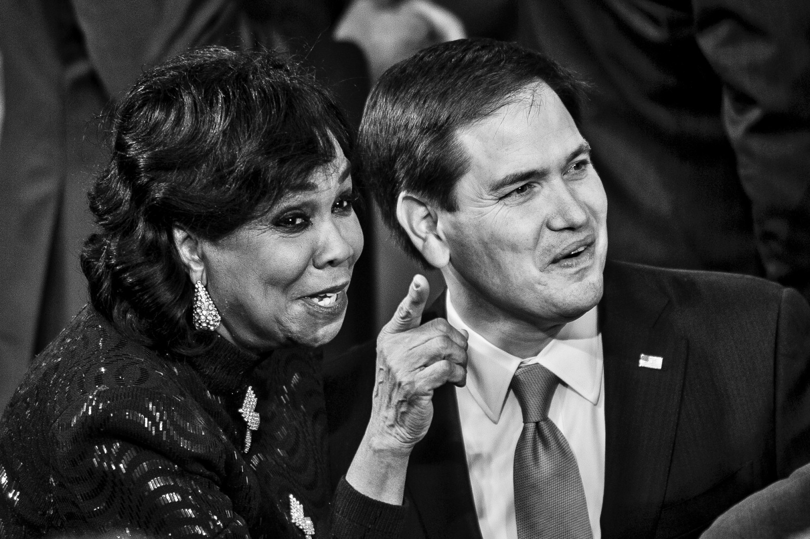 Rep. Frederica Wilson (D-FL) talks with Senator Marco Rubio (R-FL) before U.S. President Barack Obama delivers the State of the Union address to a joint session of Congress at the Capitol in Washington, District of Columbia, U.S., on Tuesday, Jan. 20, 2015.