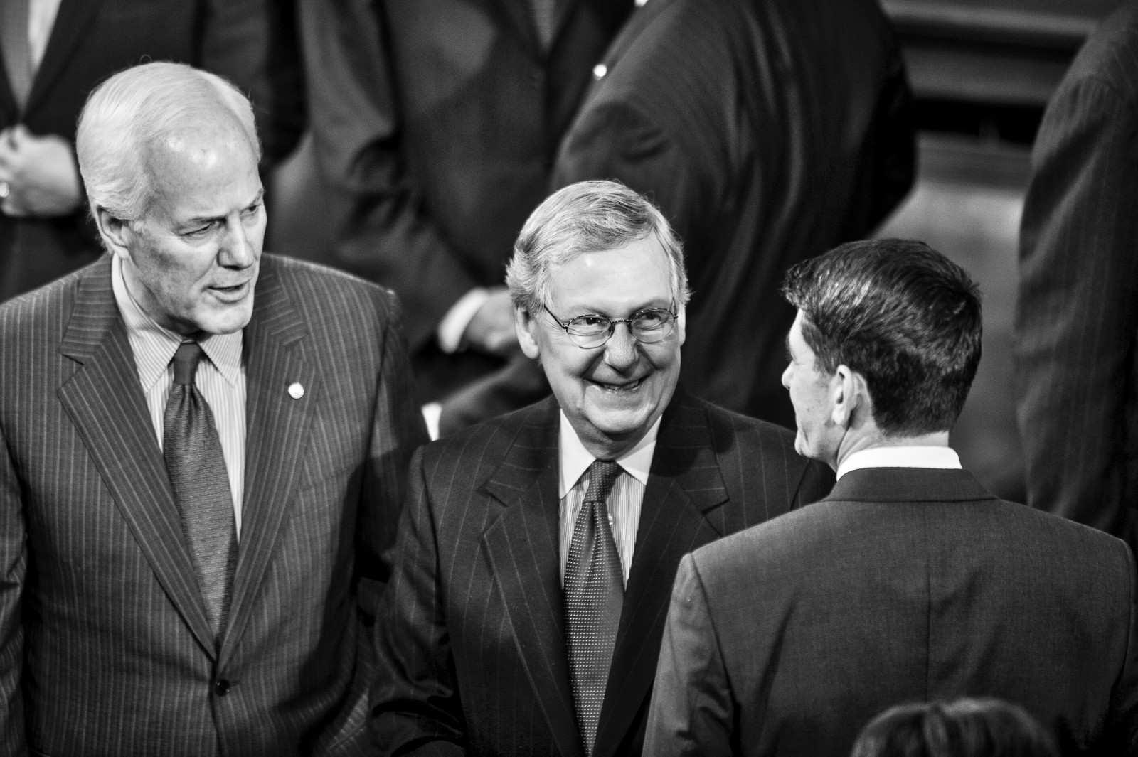Senator John Cornyn (R-TX) looks on as Senate Majority Leader Mitch McConnell (R-KY) talks with Rep. Paul Ryan (R-WI) before U.S. President Barack Obama delivers the State of the Union address to a joint session of Congress at the Capitol in Washington, District of Columbia, U.S., on Tuesday, Jan. 20, 2015.