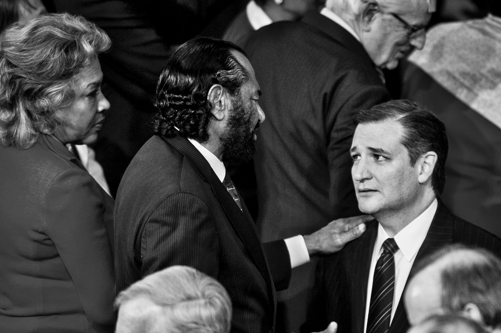 Senator Ted Cruz (R-TX), right, is greeted by Rep. Al Green (D-TX) before U.S. President Barack Obama delivers the State of the Union address to a joint session of Congress at the Capitol in Washington, District of Columbia, U.S., on Tuesday, Jan. 20, 2015.