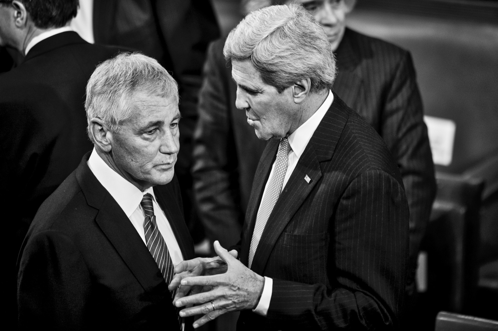 Secretary of Defense Chuck Hagel and Secretary of State John Kerry confer on the House floor before U.S. President Barack Obama delivers the State of the Union address to a joint session of Congress at the Capitol in Washington, District of Columbia, U.S., on Tuesday, Jan. 20, 2015.