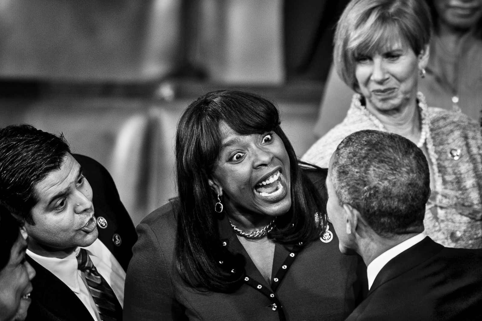 U.S. President Barack Obama is greeted Rep. Terri Sewell (D-AL) as he arrives to deliver the State of the Union address to a joint session of Congress at the Capitol in Washington, District of Columbia, U.S., on Tuesday, Jan. 20, 2015.