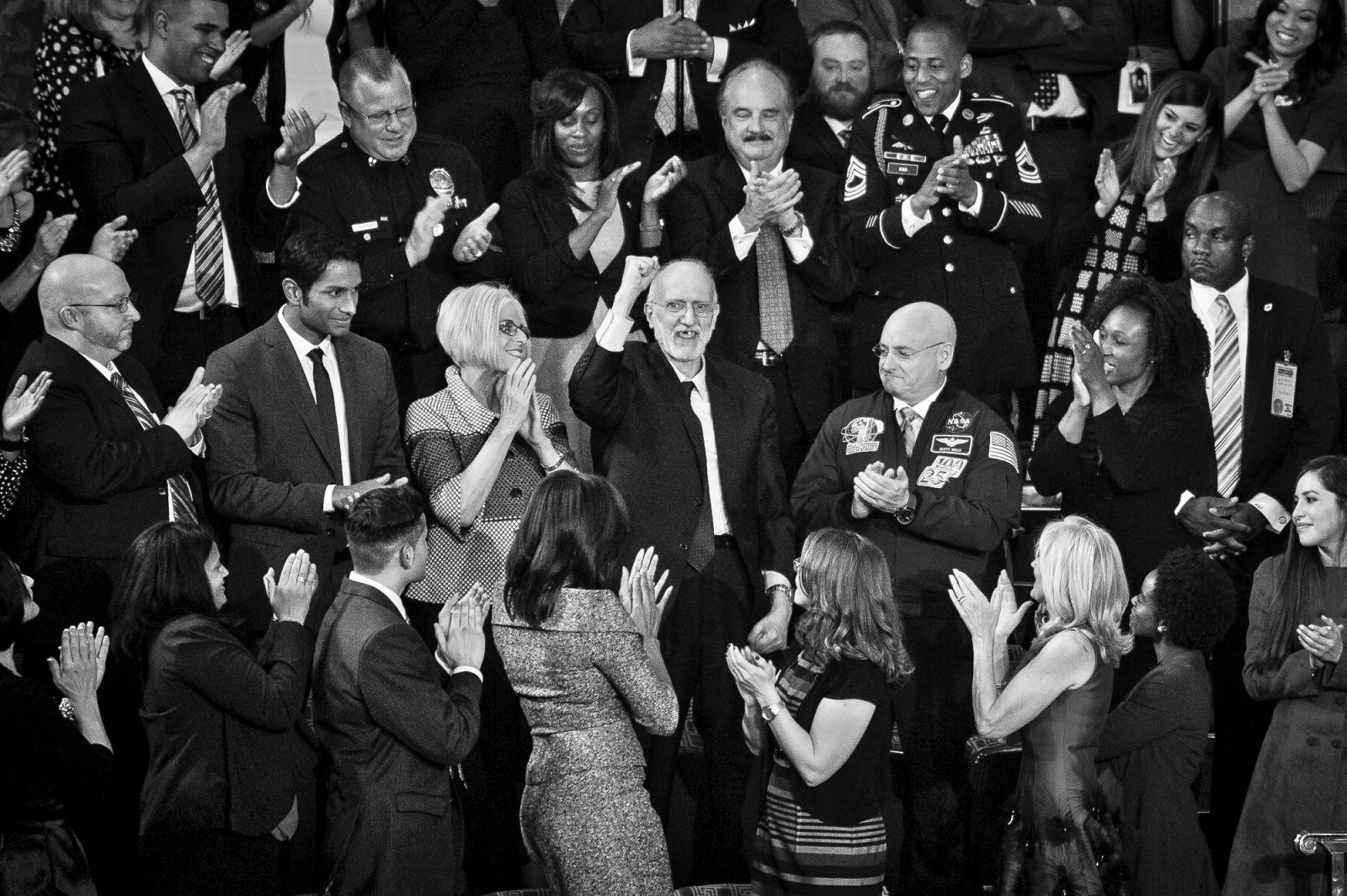 Former Cuban captive Alan Gross acknowledges the applause after being recognised by U.S. President Barack Obama during the State of the Union address to a joint session of Congress at the Capitol in Washington, District of Columbia, U.S., on Tuesday, Jan. 20, 2015.
