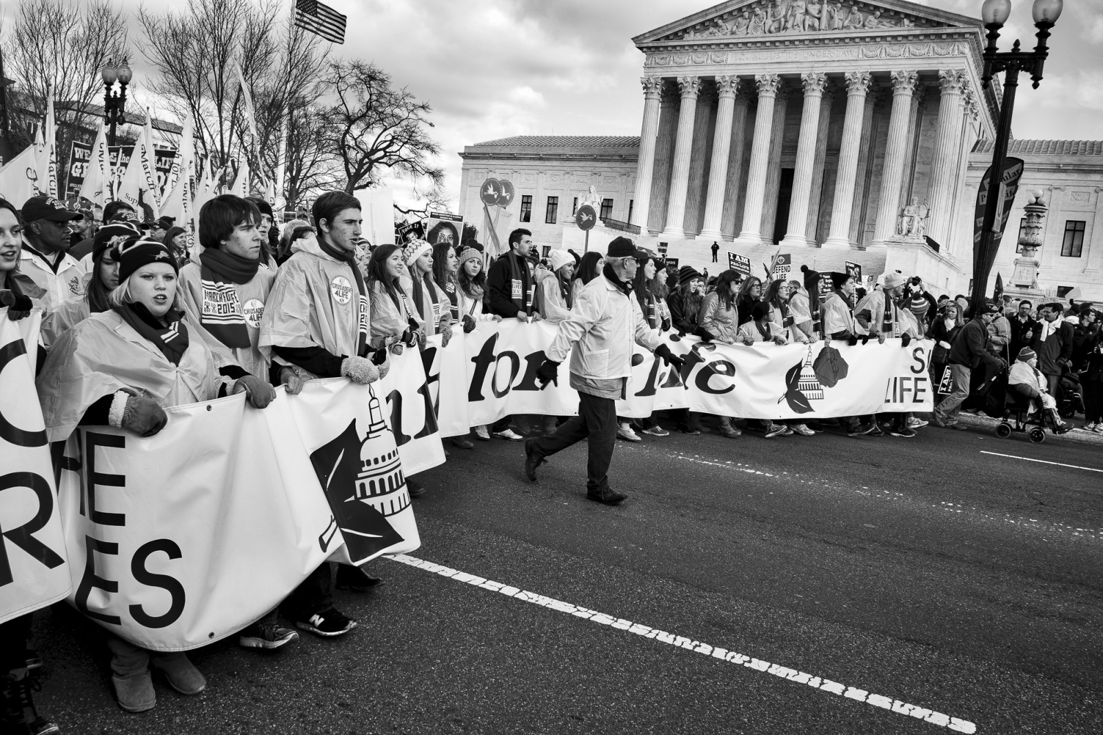 Anti-abortion activists pass in front of the US Supreme Court as they take part in the 42nd March for Life in Washington, DC on January 22, 2015. Activists from across the nation participated in the annual pro-life rally protesting abortion and the 1973 Roe v. Wade Supreme Court decision legalizing abortion. UPI/Pete Marovich