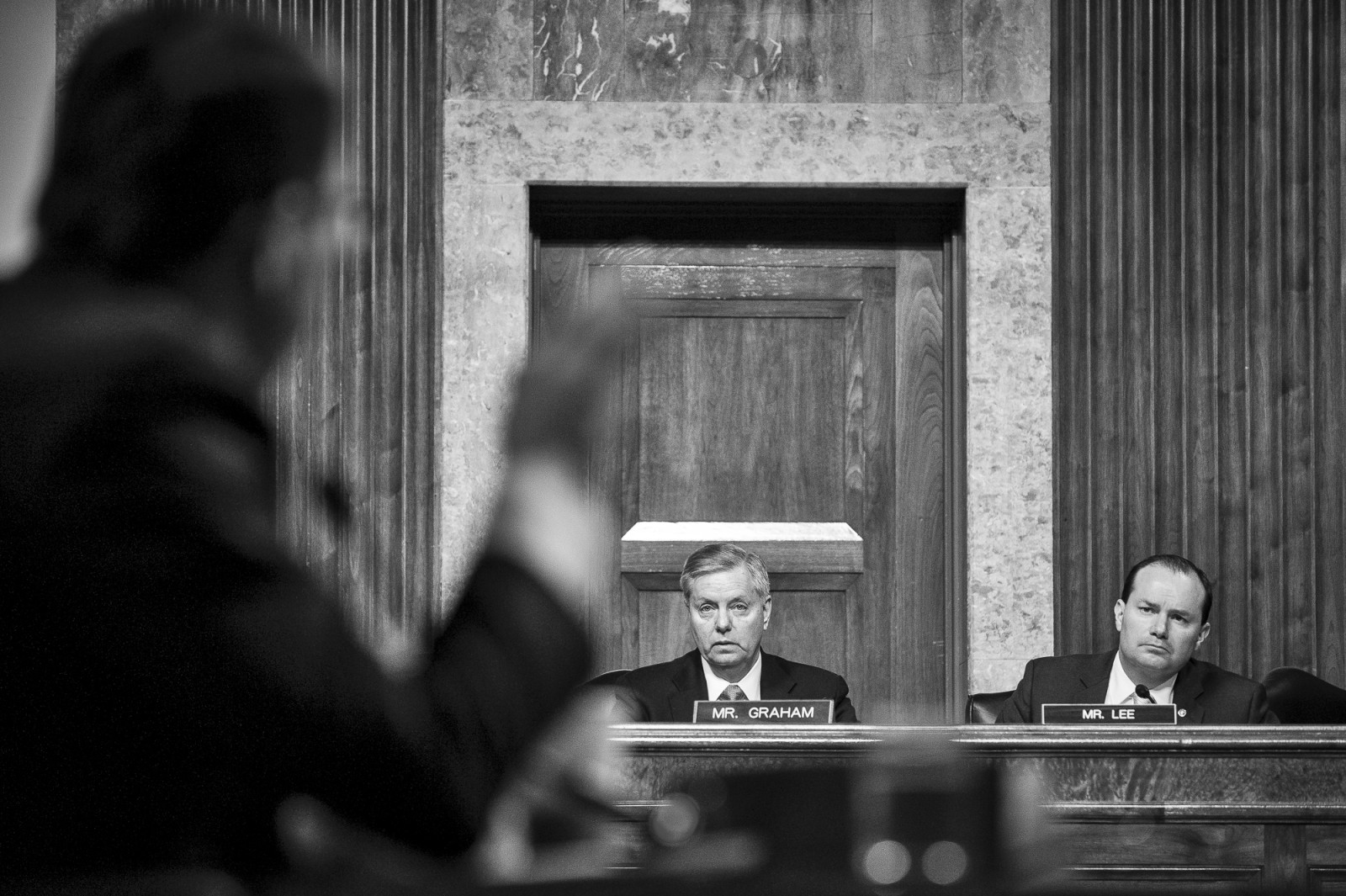 Senators Lindsey Grahman (R-SC) and Mike Lee (R-UT), listen as former deputy secretary of defense, Ashton Carter, testifies before the Senate Armed Services Committee on Capitol Hill during a hearing on his nomination to be Defense Secretary on February 4, 2015. Carter is expected to be approved by the Senate, but still underwent a grilling from lawmakers President Obama's national security policies.