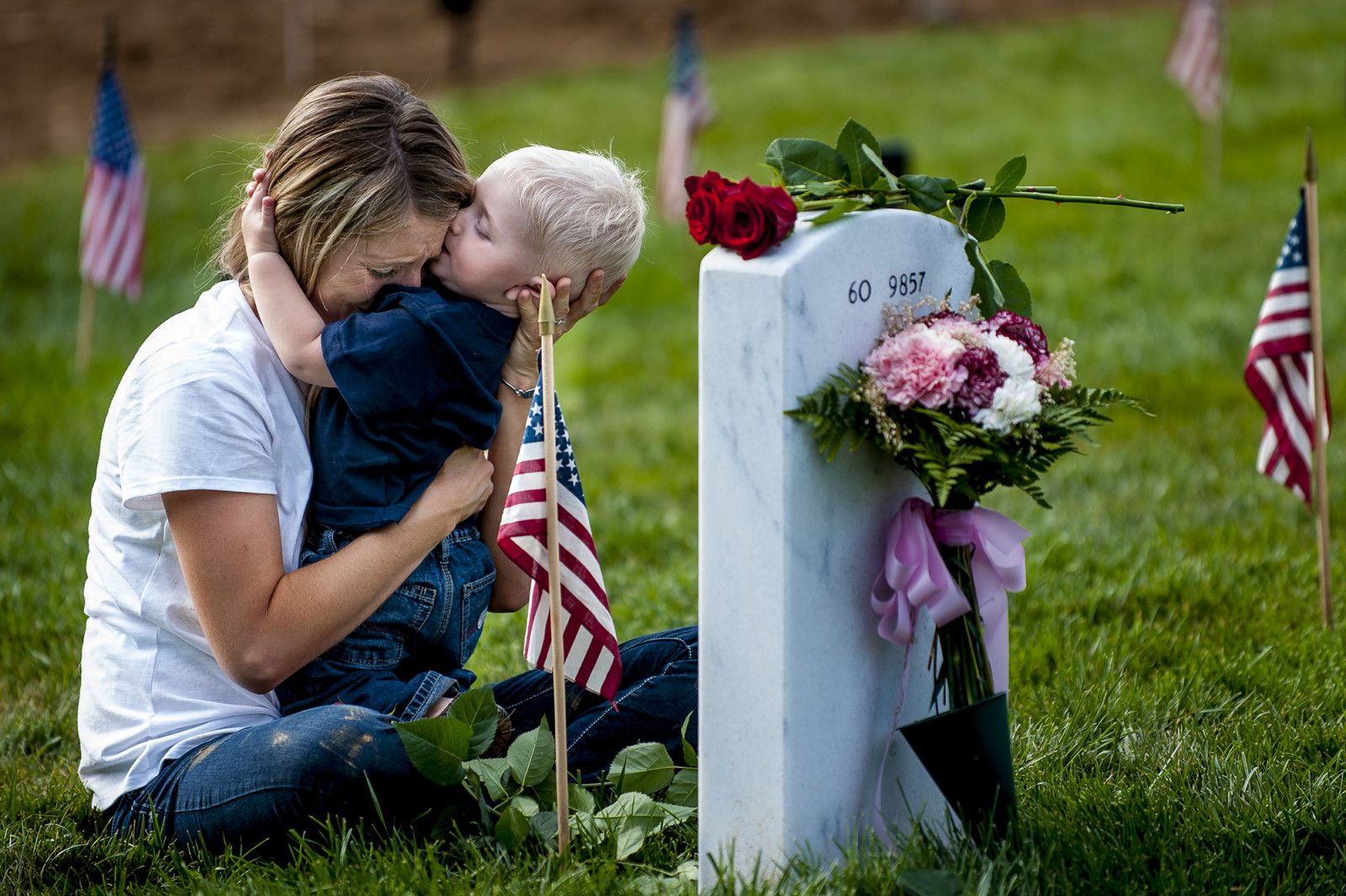 Brittany Jacobs of Hertford, NC, hugs her 17-month old son Christian at her husband, Marine SGT Christopher Jacobs' gravesite in Arlington National Cemetery on Memorial Day in Arlington, VA, USA on 28 May, 2012. (Pete Marovich/ European PressPhoto Agency)