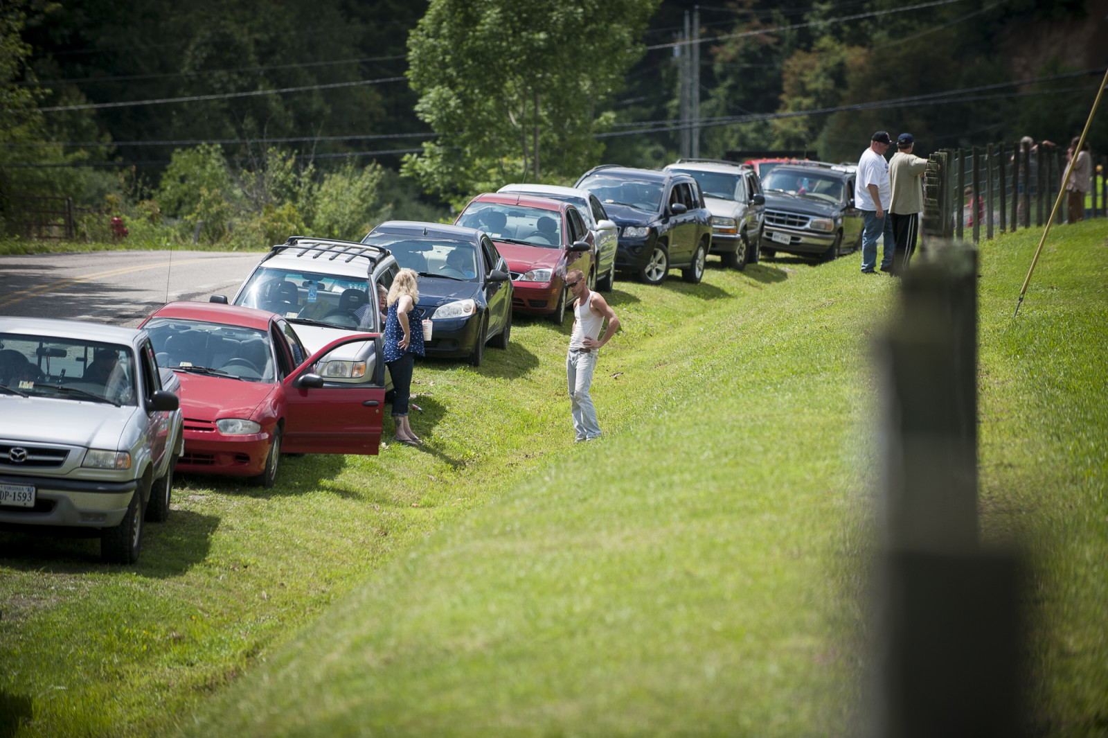 People wait for the gates to open at the Wise County Fairgrounds where they hope to receive free medical care at the 16th annual Remote Area Medical (RAM), clinic in Wise, Virginia, U.S., on Thursday, July 16, 2015. Photo: Pete Marovich/Bloomberg