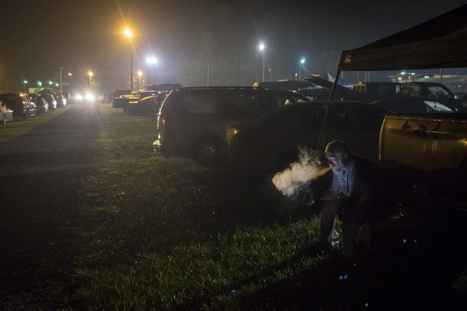 People spend the night in the parking lot at the Wise County Fairgrounds, where they hope to receive free medical care the next day at the 116th annual Remote Area Medical (RAM), clinic in Wise, Virginia. Photo: Pete Marovich/Bloomberg