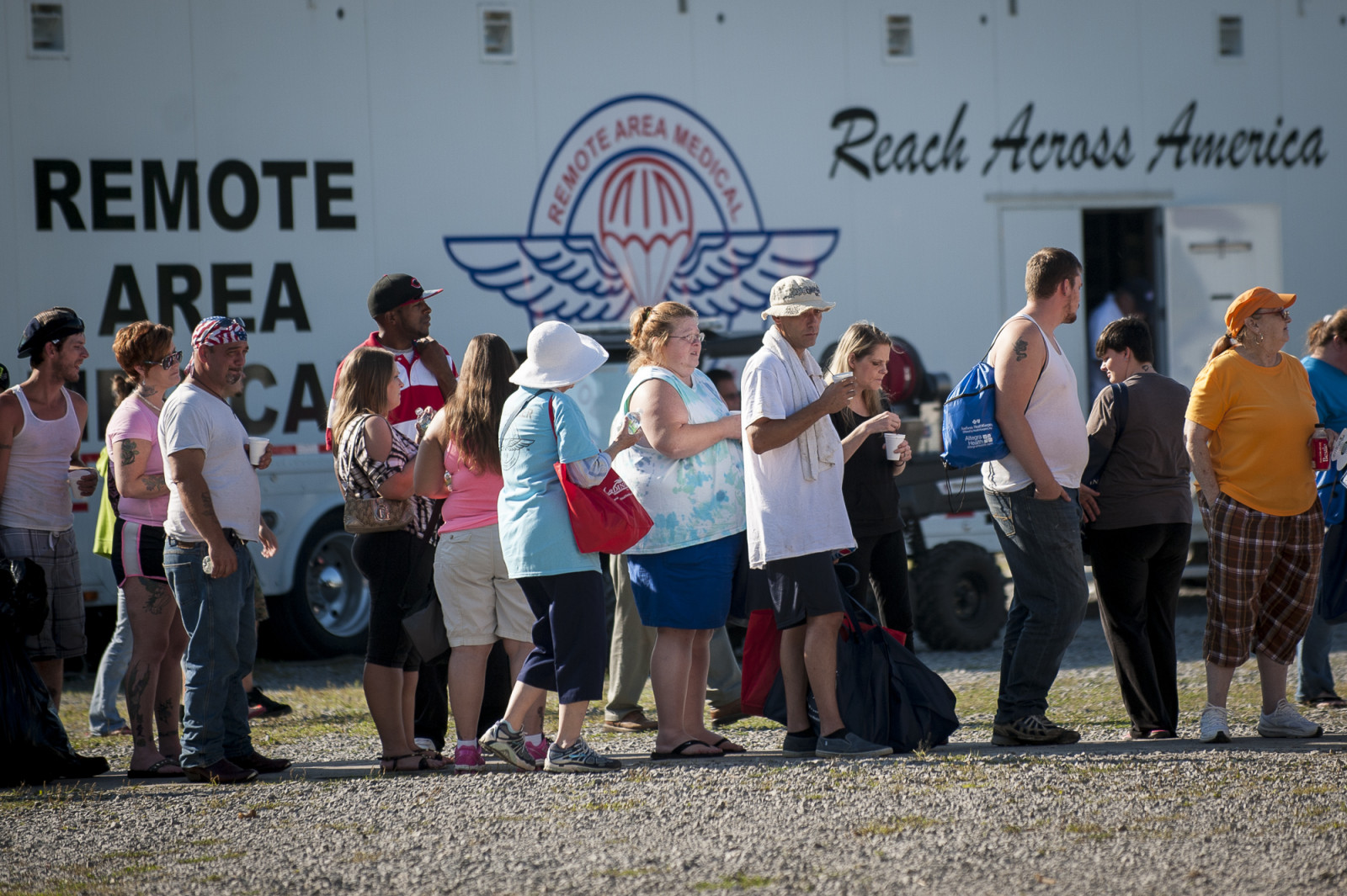 People stand in line to be processed in the triage tent at the 16th annual Remote Area Medical (RAM), clinic in Wise, Virginia, U.S., on Friday, July 17, 2015. Photo: Pete Marovich/Bloomberg