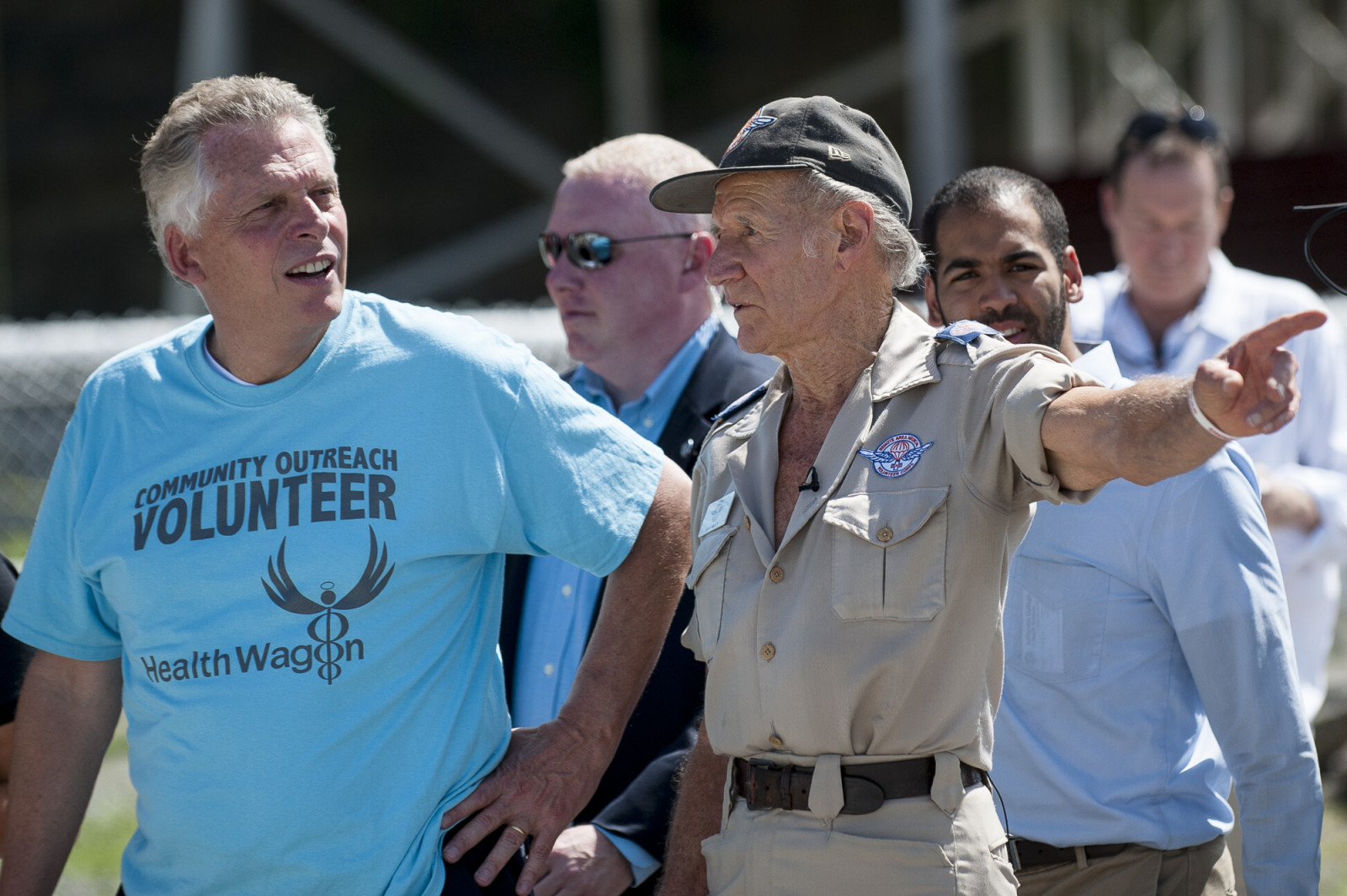 RAM Founder Stan Brock, left, gives Virginia Governor Terry McAuliffe, left, a tour at the16th annual Remote Area Medical (RAM), clinic in Wise, Virginia, U.S., on Friday, July 17, 2015. Photo: Pete Marovich/Bloomberg