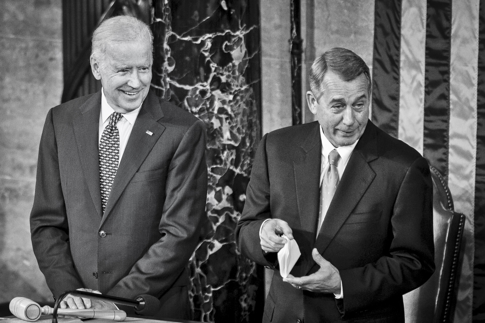 Vice President Joe Biden looks on as Speaker of the House John Boehner shows that he has a handkerchief ready for any tears he may shed as Pope Francis speaks to a joint meeting of Congress at the U.S. Capitol in Washington, District of Columbia, U.S., on Thursday, Sept. 24, 2015. Credit: Pete Marovich/Bloomberg