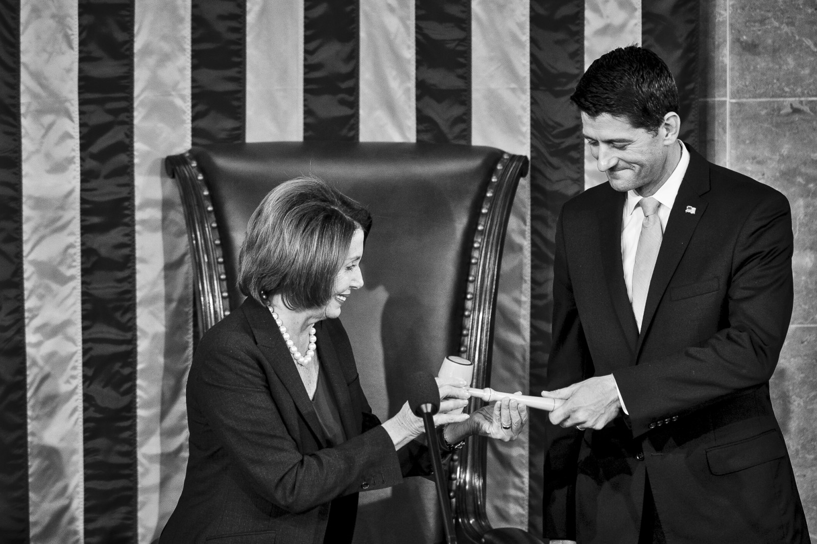 Democratic Minority Leader Nancy Pelosi passes the gavel to the 62nd Speaker of the House, Paul Ryan (R-WI) on October 29, 2015 in Washington, D.C. Earlier the outgoing Speaker, Rep. John Boehner (R-OH), gave his farewell address to Congress. He is retiring on October 30, 2015. Photo by Pete Marovich/UPI
